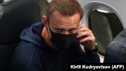 Russian opposition leader Aleksei Navalny is seen in a Pobeda plane after it landed at Moscow's Sheremetyevo airport on January 17.