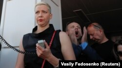 Maryya Kalesnikava addresses participants during a demonstration to protest the election result in Minsk in August 17