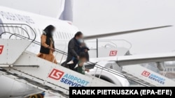 A plane from Polish airlines LOT with evacuated refugees from Afghanistan lands at an airport in Warsaw on August 23.