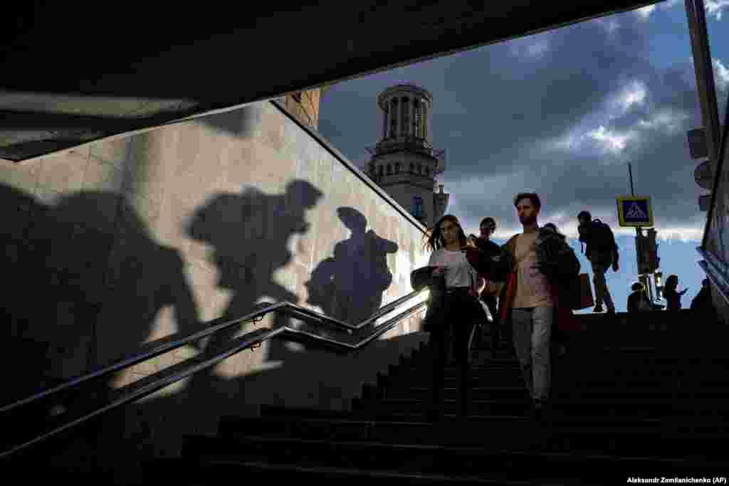 People walk down an underpass during sunset in Moscow on September 15. (AP/Alexander Zemlianichenko)