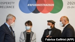 Special Representative of the UN Afghanistan envoy Deborah Lyons, Afghan Economy Minister Abdul Hadi Arghandiwal, and Afghan Foreign Minister Mohammad Hanif Atmar at the donors' conference in Geneva on November 24.