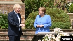بوریس جانسون صدراعظم بریتانیا و انگلا مرکل صدراعظم جرمنی