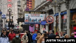 Shoppers fill the streets around Piccadilly in central London on December 12, 2020.