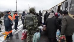 Ukrainian Civilians Flee Battle-Scarred Town
