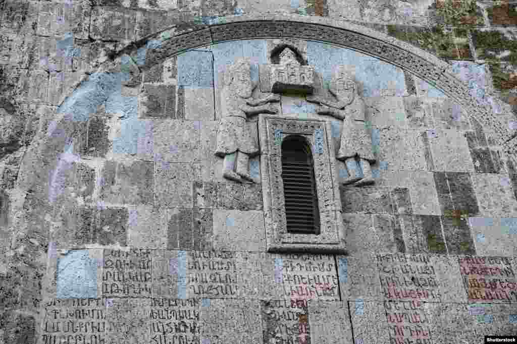 Details of a stone carving and Armenian script inside Dadivank. The monastery was completed in the 13th century.