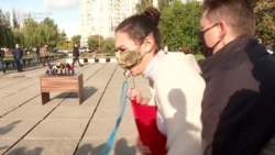 Protester Confronts Ukraine's President Outside Polling Station