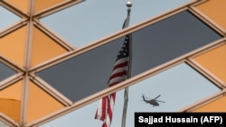 The U.S. flag and a helicopter are reflected in the windows of the U.S. Embassy in Kabul. (file photo)