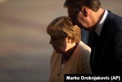 German Chancellor Angela Merkel is accompanied by Serbian President Aleksandar Vucic during her visit to Belgrade on September 13.