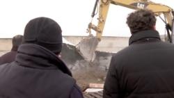 Bulldozers Roll Into Georgian Shantytown As Residents Look On