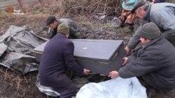 Цивільного в зоні АТО поховали у воронці від снаряда – на цвинтарі небезпечно (відео)