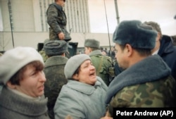 A Lithuanian woman remonstrates with a Soviet soldier in Vilnius in January 1991.