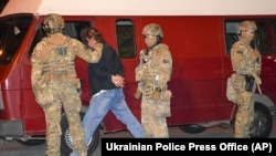 The suspected hostage taker, whom the Ukrainian Security Service (SBU) identified as 44-year-old Maksym Kryvosh, was arrested on July 21.