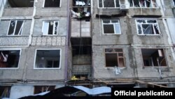 Damage to buildings in Stepanakert, the main city of Nagorno-Karabakh, after reported shelling.