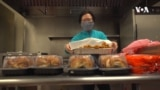 Screengrab from the VOA video 'Volunteers Bring Holiday Dinners to Homeless Shelters'.