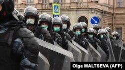 """""""Just plain, old-fashioned authoritarianism""""? Russian riot police block a street during a rally in support of jailed Kremlin critic Aleksei Navalny in central St. Petersburg on April 21."""