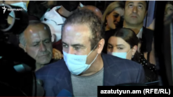 Prosperous Armenia Party leader Gagik Tsarukian speaks to the media after being released on October 22.