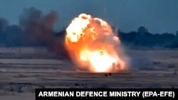 NAGORNO KARABAKH -- A still image released 29 September by the Armenian Defense Ministry shows an explosion during military clashes along the Line of Contact around Karabakh.