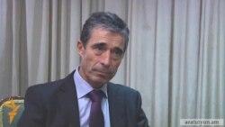 NATO Chief 'Deeply Concerned' At Azerbaijan Pardon