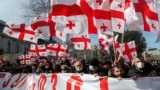 GEORGIA -- Opposition parties supporters march with Georgian flags and banners in support of Georgian opposition leader Melia in Tbilisi, February 26, 2021