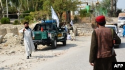 Members of the Taliban inspect the site of a blast in Jalalabad on September 18.