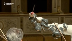 Roboti YuMi dirigjon Andrea Bocellin
