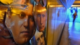 Masks of opposition leader Aleksei Navalny and President Vladimir Putin on sale at a souvenir stand in an underground passage in St. Petersburg.