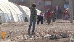 ميشيل اوباما في مخيم سروج