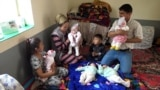 'Not Enough Mother's Milk': The Struggling Parents Of Tajikistan's First Quintuplets video grab 3