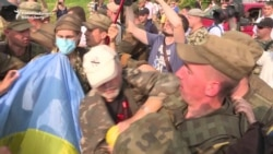 Orthodox Procession Scuffles With Protesters Near Kyiv