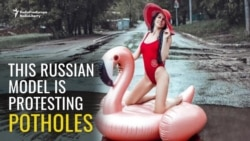 Russian Model Poses To Protest Potholes