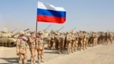 Russian troops line up before the start of joint military drills with Tajikistan and Uzbekistan north of the Tajik border with Afghanistan on August 10.