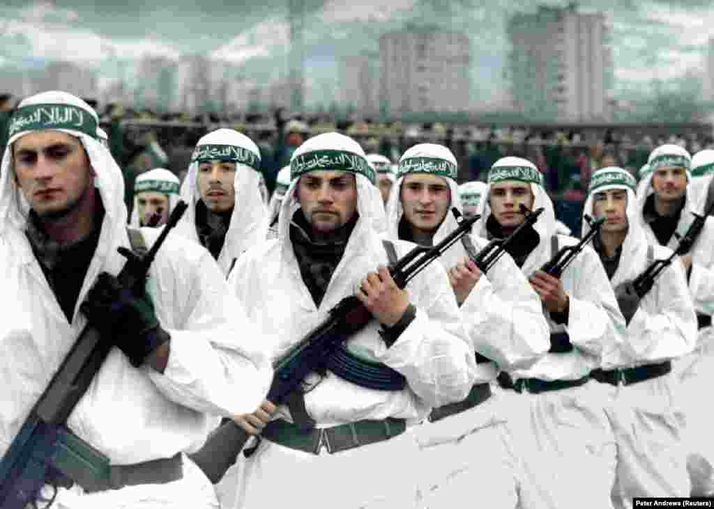 A Muslim brigade of the Bosnian Army marches in a parade in Zenica in 1995.   Bin Laden is also widely believed to have been involved in helping channel foreign jihadists to fight alongside Bosnian Muslims during the wars in the 1990s in former Yugoslavia. The foreign Islamist fighters were notorious for their brutality.