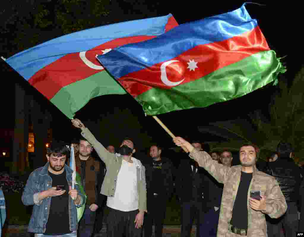 Azerbaijanis celebrate in the streets of Baku on November 10 after Armenia and Azerbaijan agreed on a deal with Russia to end weeks of fierce clashes over Nagorno-Karabakh after a string of Azerbaijani victories in its fight to retake the breakaway region. (AFP/Tofik Babayev)