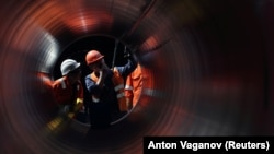 Workers are seen at a construction site of the Nord Stream 2 gas pipeline