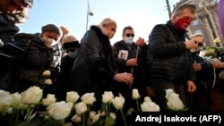 People gather in Belgrade to remember the medical staff who have lost their lives to COVID-19.