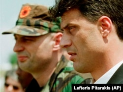 Kosovo Liberation Army leader Hashim Thaci (right) attends a memorial ceremony for ethnic Albanian leader Fehmi Agani in Pristina on August 6, 1999.