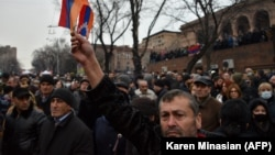 ARMENIA -- Opposition supporters rally outside the National Assembly building to demand Prime Minister Nikol Pashinian's resignation, March 1, 2021