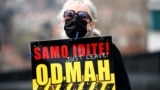 BOSNIA-HERZEGOVINA -- A woman holds a sign during a protest urging the government to obtain coronavirus disease (COVID-19) vaccines, in Sarajevo, April 6, 2021