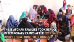 'They Would Cut Us Into Pieces': Afghan Civilians Flee Taliban Attacks In Kunduz