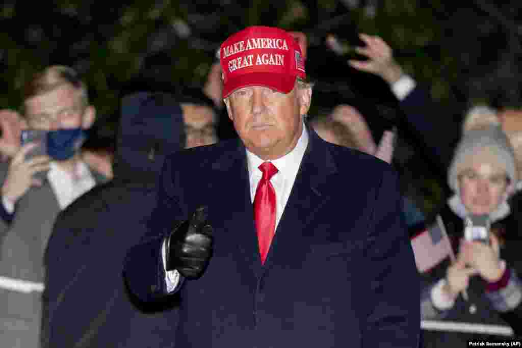 President Donald Trump gestures as he walks on the South Lawn of the White House in Washington, Tuesday, Nov. 3, 2020, after stepping off Marine One and greeting supporters. Trump is returning from campaign events in North Carolina, Pennsylvania,