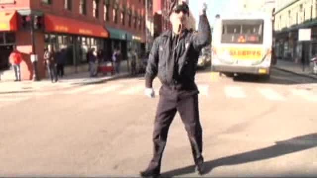 U.S. Policeman Directs Traffic With Dance Moves
