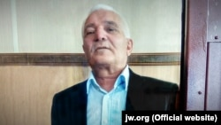 "Yury Savelyev said in a statement in court last week that he is being prosecuted ""simply for being a follower of the religious teachings of the Jehovah's Witnesses."""
