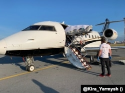 Aleksei Navalny is loaded onto an air ambulance in Omsk on August 22.