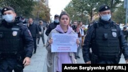 """The protesters held up small placards reading, """"There are no foreign agents, there are journalists."""""""