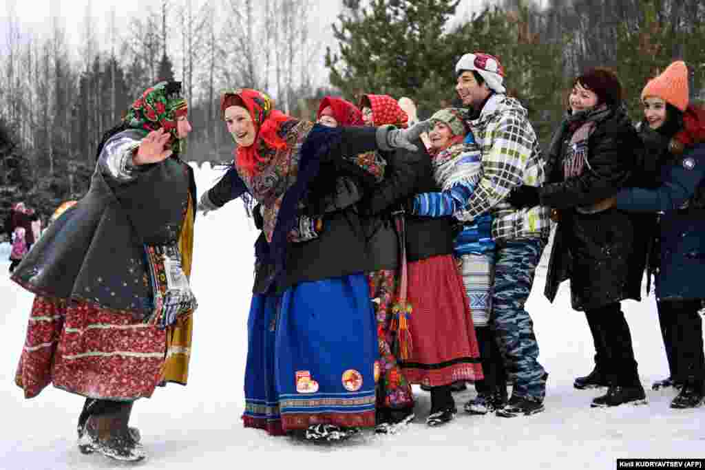Russians in traditional dress celebrate Maslenitsa close to the village of Gzhel, about 60 kilometers from Moscow.
