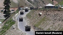 An Indian army convoy moves towards Leh, the capital of the Ladakh region on June 15.