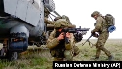 Russian troops take part in drills in Crimea, which Moscow forcibly seized from Ukraine in 2014.