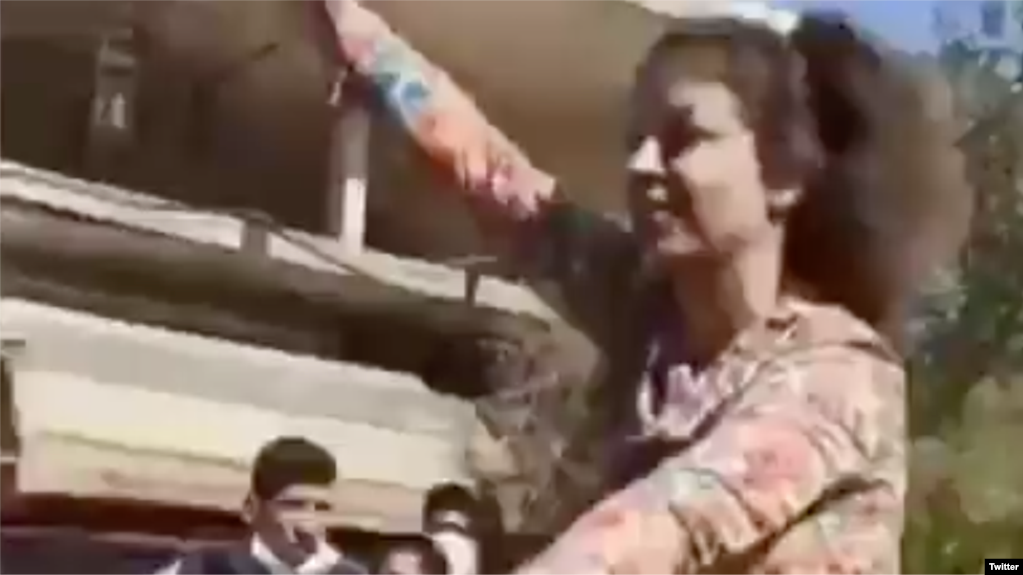 Hard-liners have taken to the streets of the conservative Iranian city of Najafabad to condemn this woman for riding a bicycle without wearing a veil.