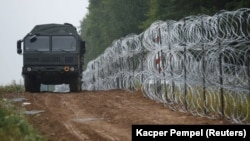 Poland has sent thousands of soldiers to its borders and also started building a barbed-wire fence.