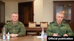Armenia -- Lieutenant-General Rustam Muradov (R), the commander of Russian peacekeepering forces stationed in Nagorno-Karabakh, meets with Armenian Defense Minister Vagharshak Harutiunian, Yerevan, February 10, 2021.
